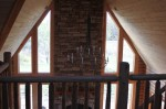 Great Room ceiling (tongue and groove cedar boards), chimney (cultured ledgestone) and chandelier taken from the loft