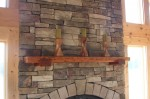 Fireplace mantle made of reclaimed hemlock wood with solid cherry corbels