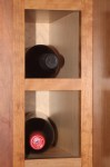 Some of the wine cubbies in our Kitchen cabinetry (natural solid cherry)