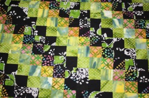 Batik (around the world pattern) quilt made by Corey's co-worker Mary Lu