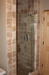 Master Bath travertine stall shower with Kohler Purist line door and fixture