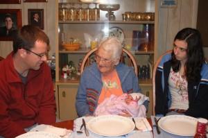 Great Grandma Hensinger meets Sophia with cousin Dana watching