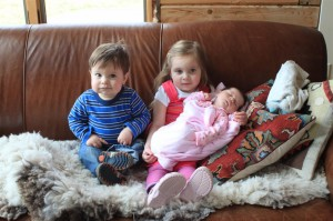 Amelia and Sammy pose with their new cousin Sophia