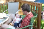 Baby Sophia naps in Daddy's lap