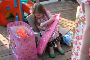 Amelia opens her first gift