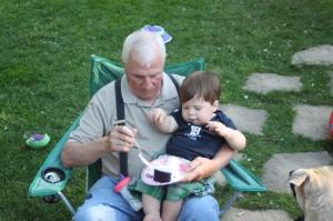 Papa Blair and Sammy eat cake