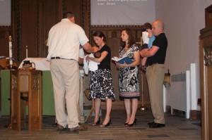 Pastor Scott blesses Sophia