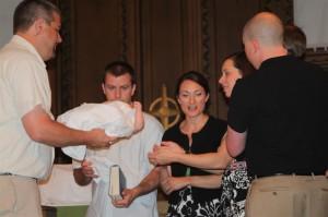 Pastor Scott baptizes Sophia