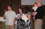 Dad receives Sophia's baptismal candle