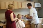 Rebecca, Will and Ade fix brunch plates