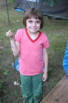 Abby and a long root she unearthed while digging in the dirt